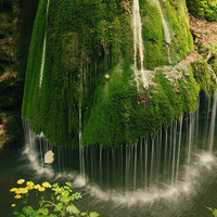 Beautiful unique waterfall in a forest nature by behindmyblueeyes