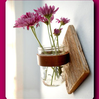 A beautiful vase on the wall. Glass and wood is original. A great gift and decor for your home. handmade