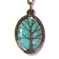 The Large Oval Turquoise Tree of Life Necklace in Antique Copper.