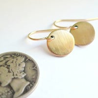 Gold circle earrings. Tiny brass discs on 14K gold fill GF ear wires. Dainty jewelry.