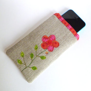 Fabric phone case or glasses case with quirky embroidered pink flower design in natural linen with bright pink floral patterned lining.