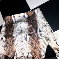 SWEET LORD O'MIGHTY! PYTHON SILK SKIRT