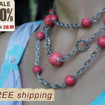 Handmade necklace of coral beads and chain.Three rows of different lengths