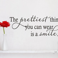 The prettiest thing you can wear is a smile- Vinyl Decal - Vinyl Lettering