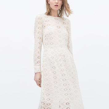 Embroidered dress with full skirt