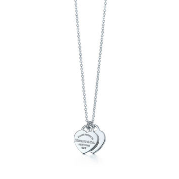 Tiffany & Co. - Return to Tiffany™ mini double heart tag pendant in sterling silver.