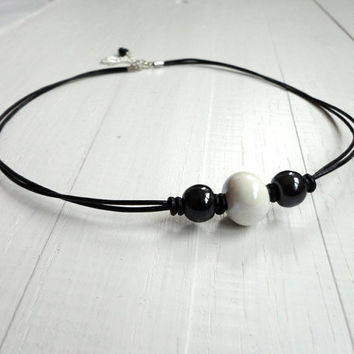 Knotted leather choker necklace white ceramic bead black glass rocker elegant