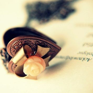 Sweet Nothings. A Lovers rose and heart locket.