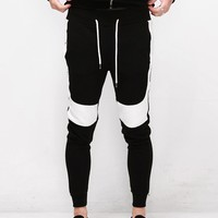Mens XQUARE 23 Contrast White Pintuck Paneled Jersey Pants at Fabrixquare