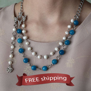 FREE shipping. Woman's necklace of freshwater pearls and blue agate, delicate butterflies element