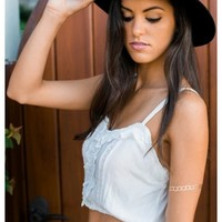 Janey - White crop top with with lace ruffle details.