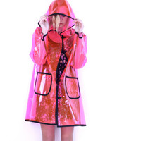 PINK plastic p o p, see through hooded raincoat . napkin