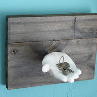White ceramic hand key holder on reclaimed weathered wood, wall piece