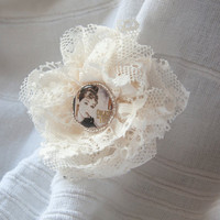Large brooch with layered vintage lace flower ruffles and Audrey Hepburn resin button