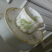 Early Antique Rosenthal German tea cup and saucer set, R C Monbijou green floral and gold gilt