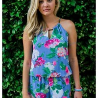 Sami - Blue playsuit with pink flowers.