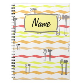 Wrench and hammer with zigzagged  lines spiral notebook