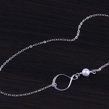 """Pearl infinity necklace, silver infinity necklace, single pearl necklace, asymmetrical necklace, bridesmaid necklace, pearl necklace, """"Oupis"""