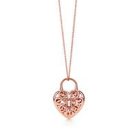 Tiffany & Co. - Tiffany Filigree Heart pendant in 18k rose gold with diamonds and gemstones.