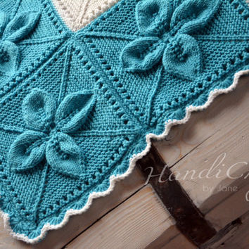 Knitted baby blanket with leaf motifs. For baby boy or baby girl. Blue and white. Baby shower gift.