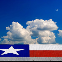 Star of Texas Flag on a hot Tin Roof with blue sky, photography art, for home and office décor. Title is: 132