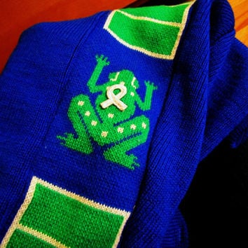 vintage royal blue sweater with kelly green frog detailing. pure virgin wool. by Demetre