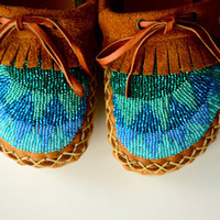 Custom beaded moccasins with warm wool lining, arch support insole and ankle tie