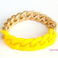 bright yellow acrylic and chunky gold bracelet