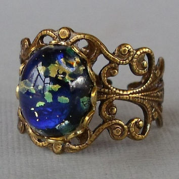 Blue Glass Opal Ring With Antique Brass by pinkingedgedesigns