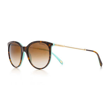 Tiffany & Co. - Tiffany Twist round sunglasses in gold-colored metal and tortoise acetate.