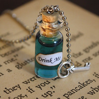 Alice in Wonderland Drink Me Vial Necklace by spacepearls on Etsy