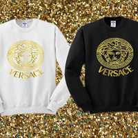 Versace gold logo crewneck sweater available for men and woman unisex adult