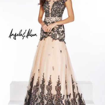 Elegant tulle mermaid gown with a high illusion neckline and intricate lace details.