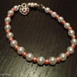 Pink 'n' White beaded Bracelet with cute heart charm -