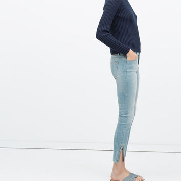 JEANS WITH ZIPPED HEM
