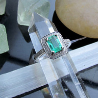 Emerald Ring in 14K White Gold and Diamond Halo by pristinejewelry
