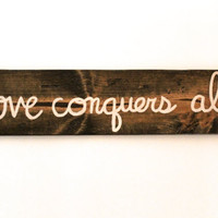 """Custom quote sign """"love conquers all"""""""